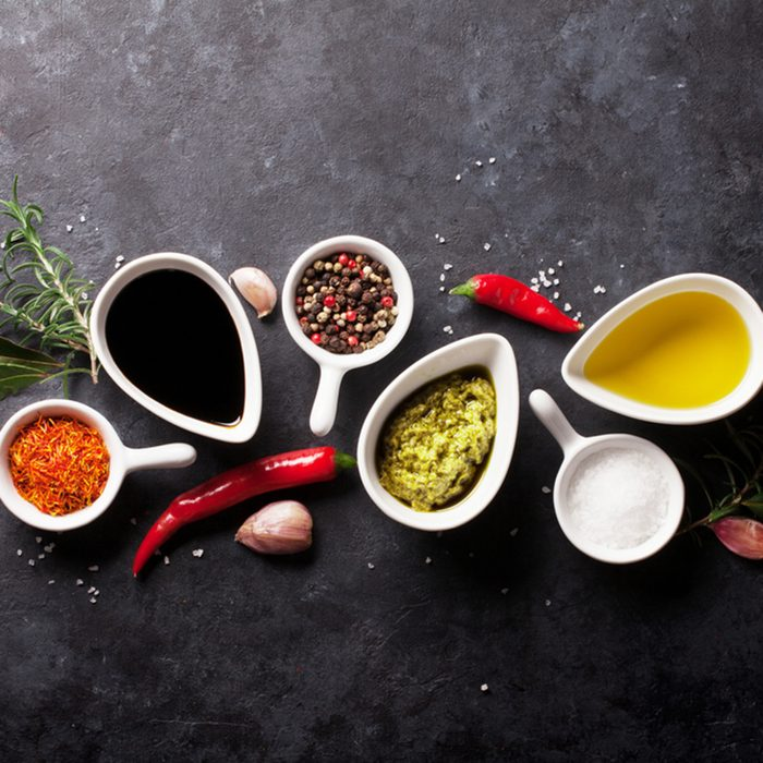 Herbs, condiments and spices on stone background