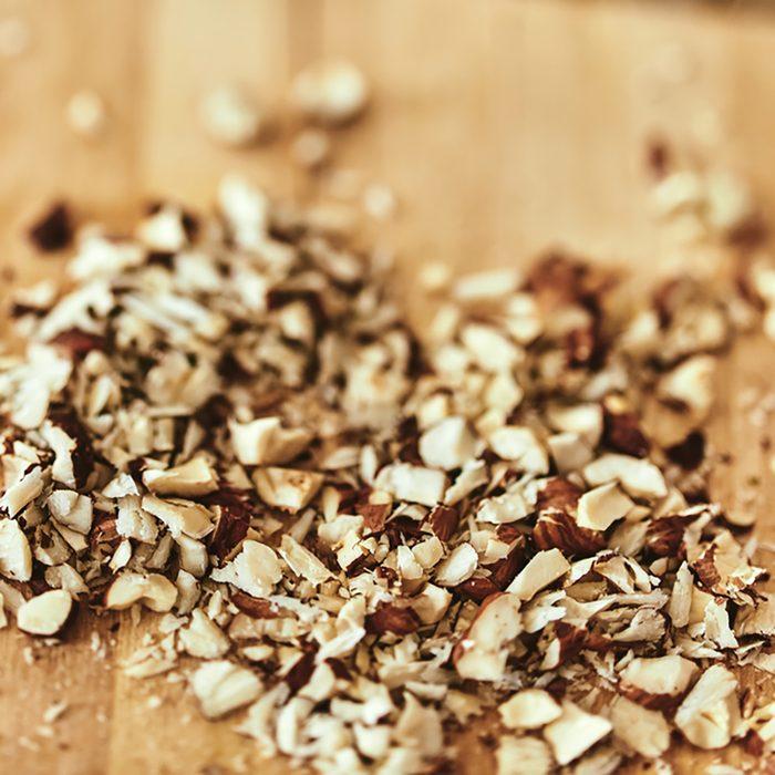 chopped walnuts on a wooden board