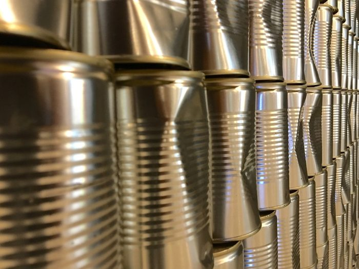 Rows of aluminium cans as backdrop of a food and beverages outlet