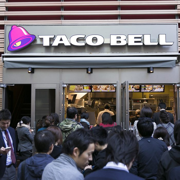 People queue outside new Taco Bell restaurant, Tokyo, Japa