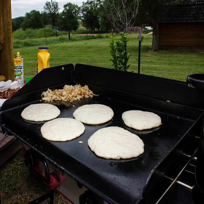 Pancakes and hashbrooms good on a camp griddle stove at a campground in rural Wyoming in the summer.