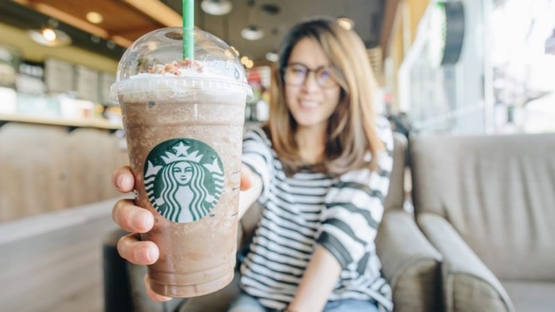 women holding a venti cup of frappuccino