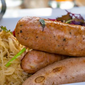 German sausages with sauerkraut, cabbage meal. Food background