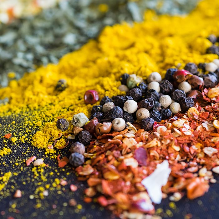 Spices and herbs on a black background; Shutterstock ID 545932456