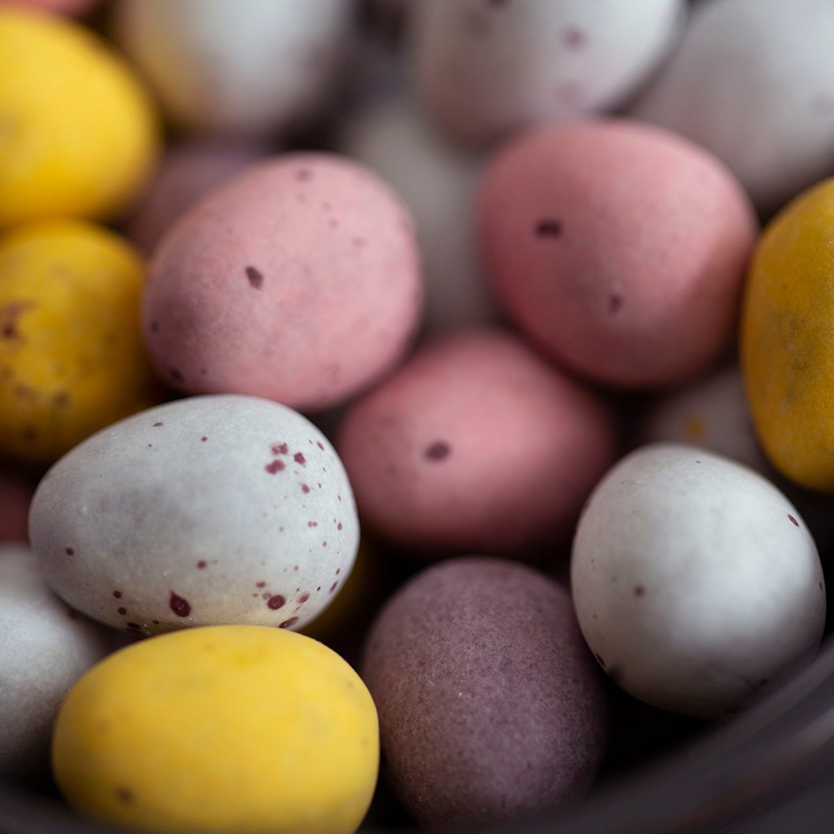 A bowl of pretty pastel Easter eggs.