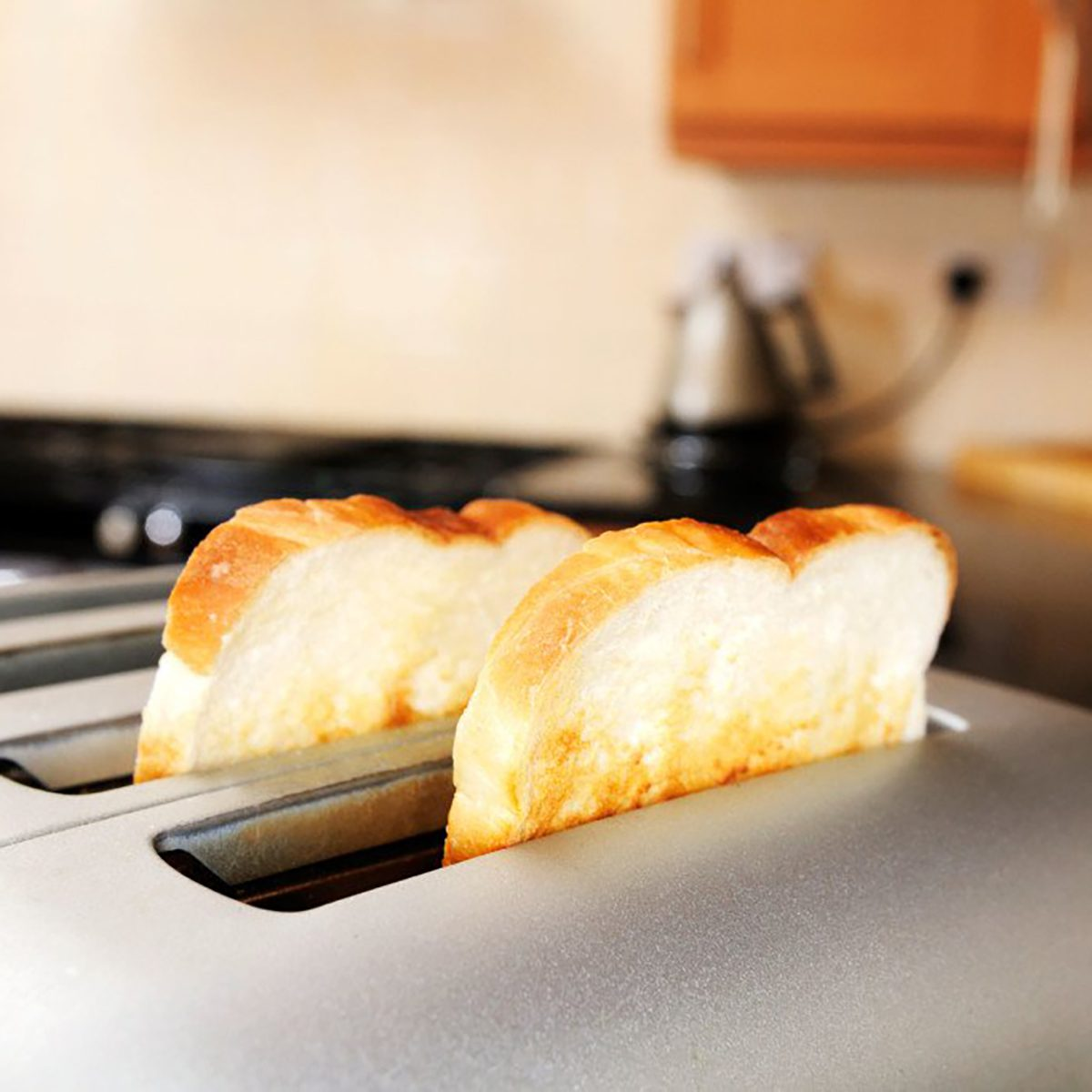 bread popping up from toaster