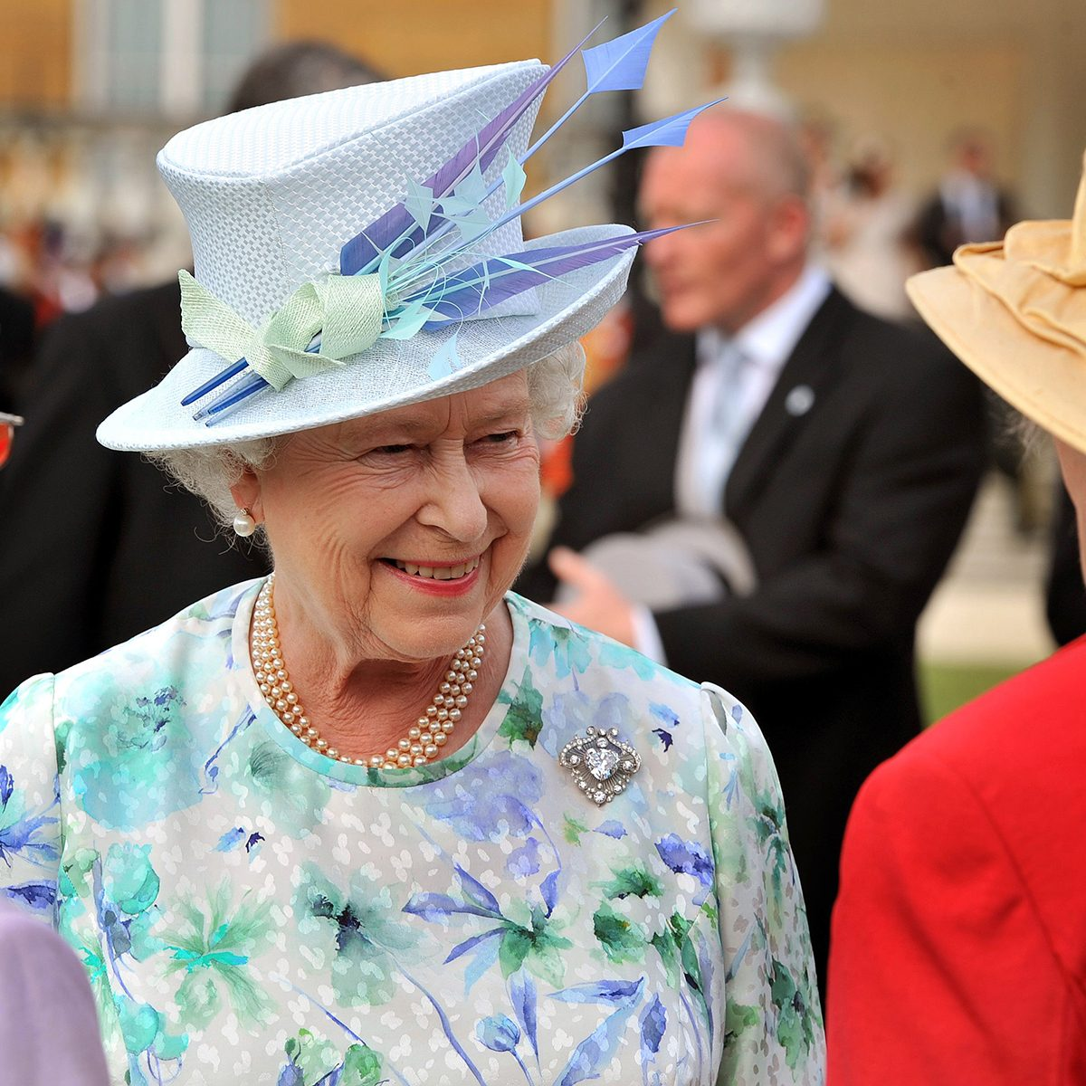 Queen Elizabeth II talks to guests Garden Party at Buckingham Palace, London, Britain