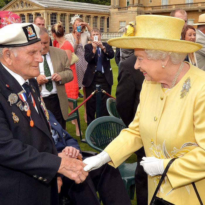 Queen Elizabeth II talks to a veteran Not Forgotten garden party at Buckingham Palace, London, Britain