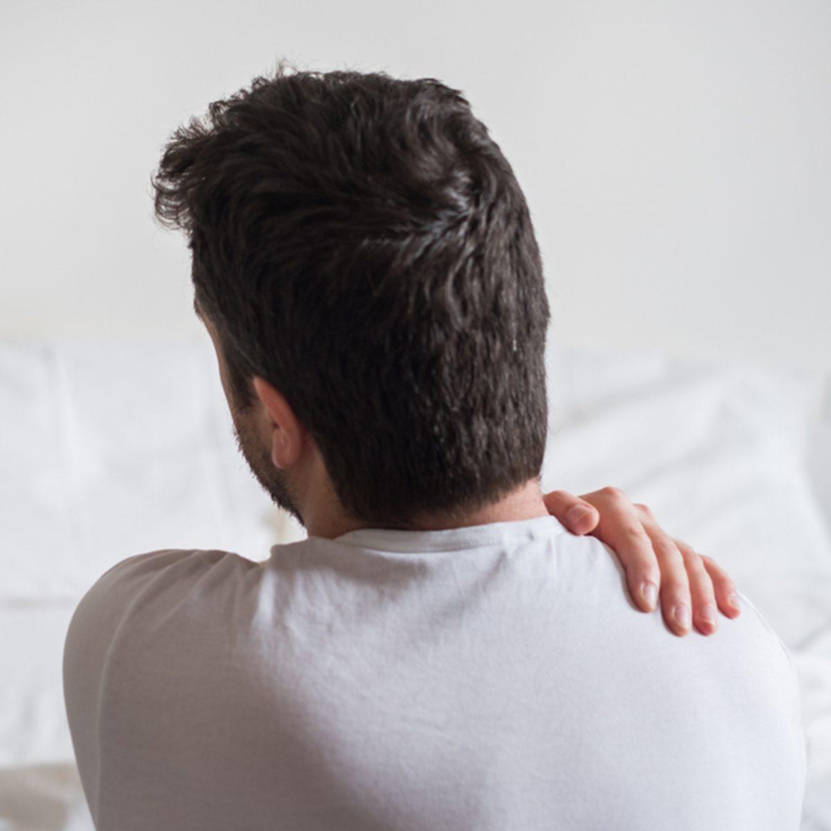 Man holding his shoulder