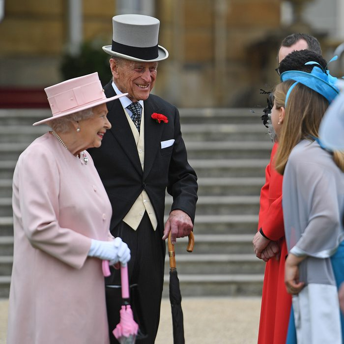Queen Elizabeth II and Prince Philip talk to guests during a garden party at Buckingham Palace in London.