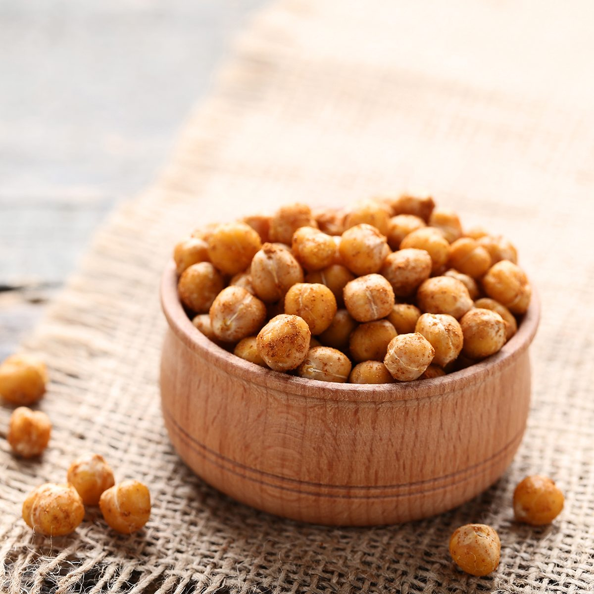 Roasted chickpeas in bowl on gray wooden table