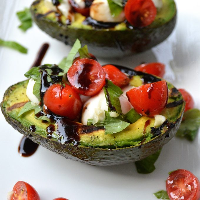 Grilled avocado caprese salad