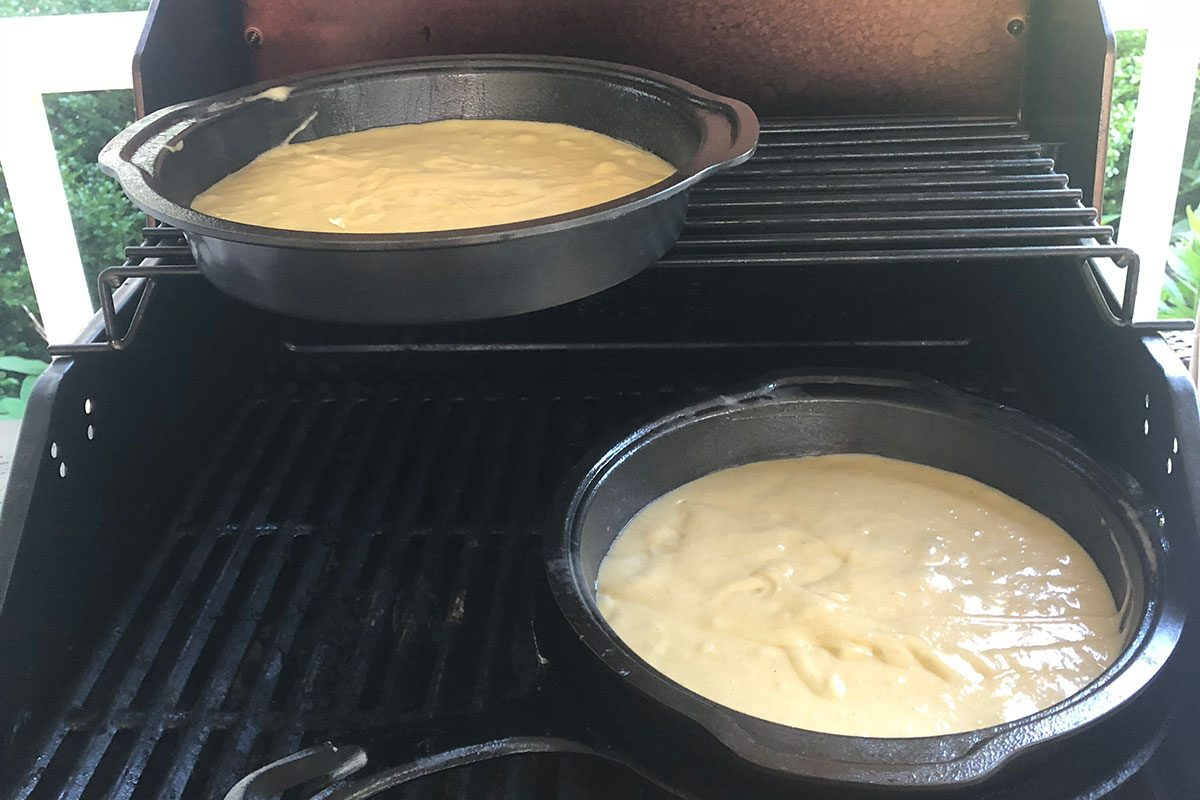 Cakes in pans on the grill