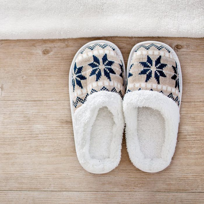 Slippers at the side of a bed