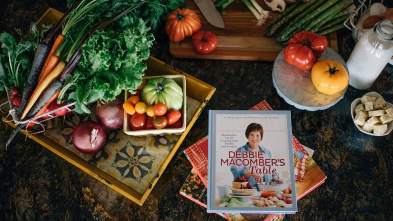 Selection of produce around a cookbook