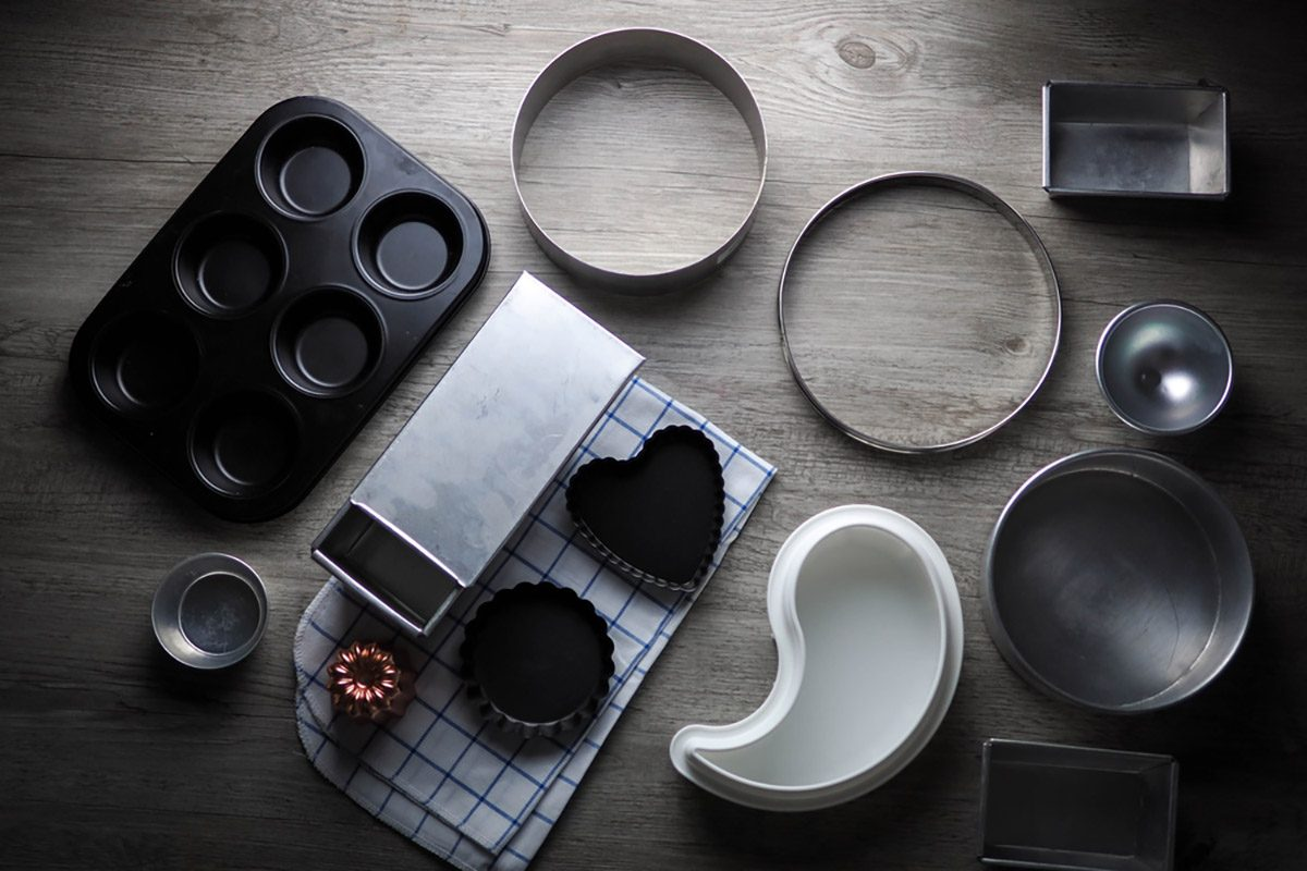 Bakeware (bakery tools) on wood table.