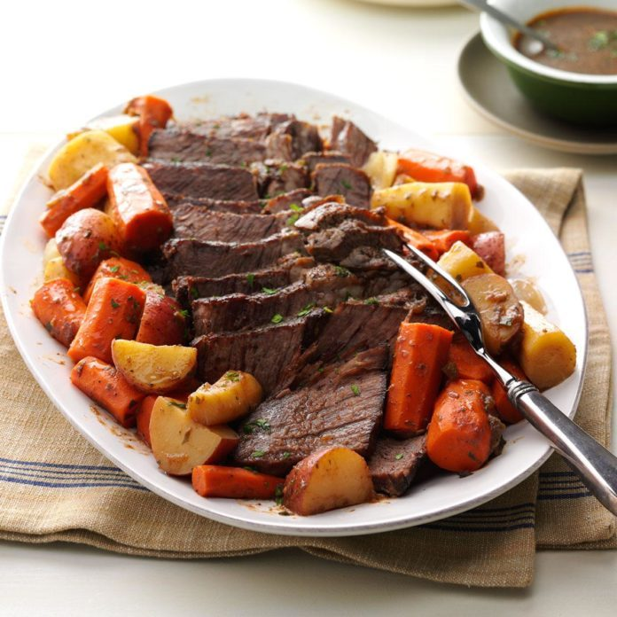 A platter filled with the Ultimate Pot Roast and vegetables