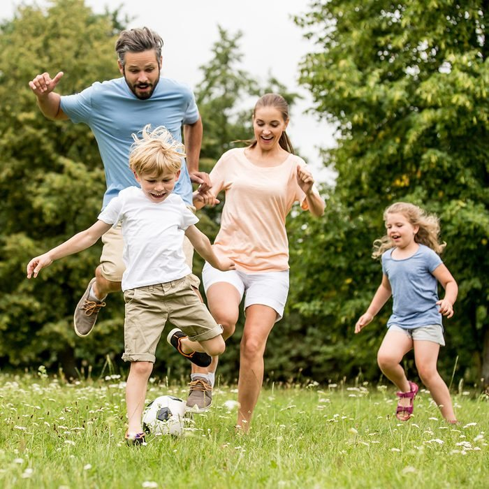 Active family play soccer in their leisure time; Shutterstock ID 1013869084; Job (TFH, TOH, RD, BNB, CWM, CM): Taste of Home