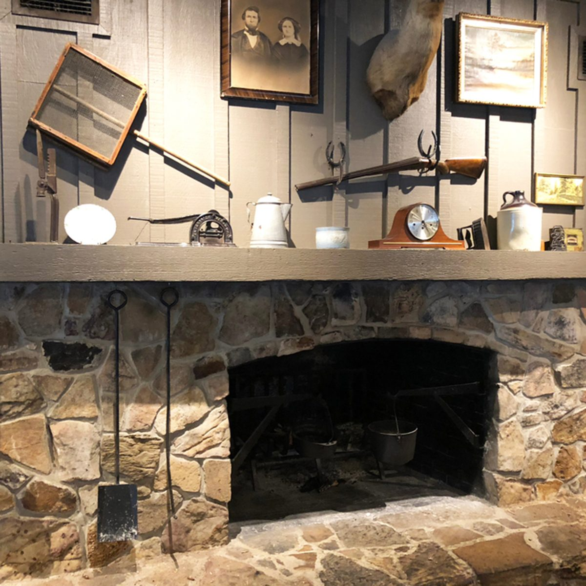 Nostalgic stone fireplace inside a Craker Barrel restaurant and Old Country Store.