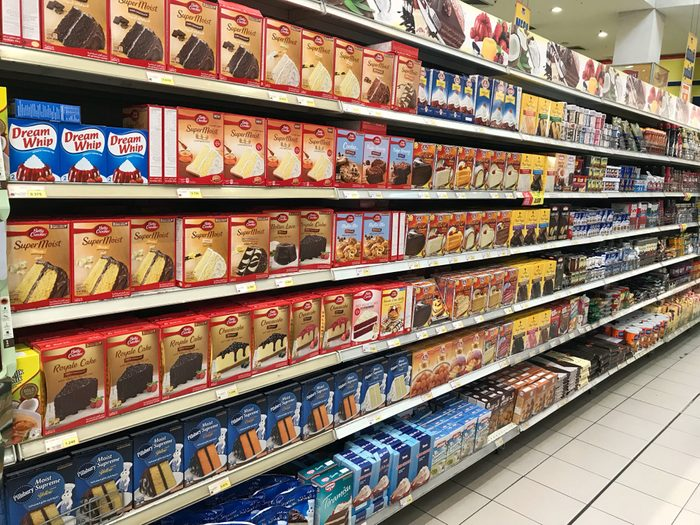KUWAIT CITY, KUWAIT - April 25, 2017 : Various brands of cake mixture that lined up on shelves in the market. Baking cake for preparation of having it on Eid Mubarak.