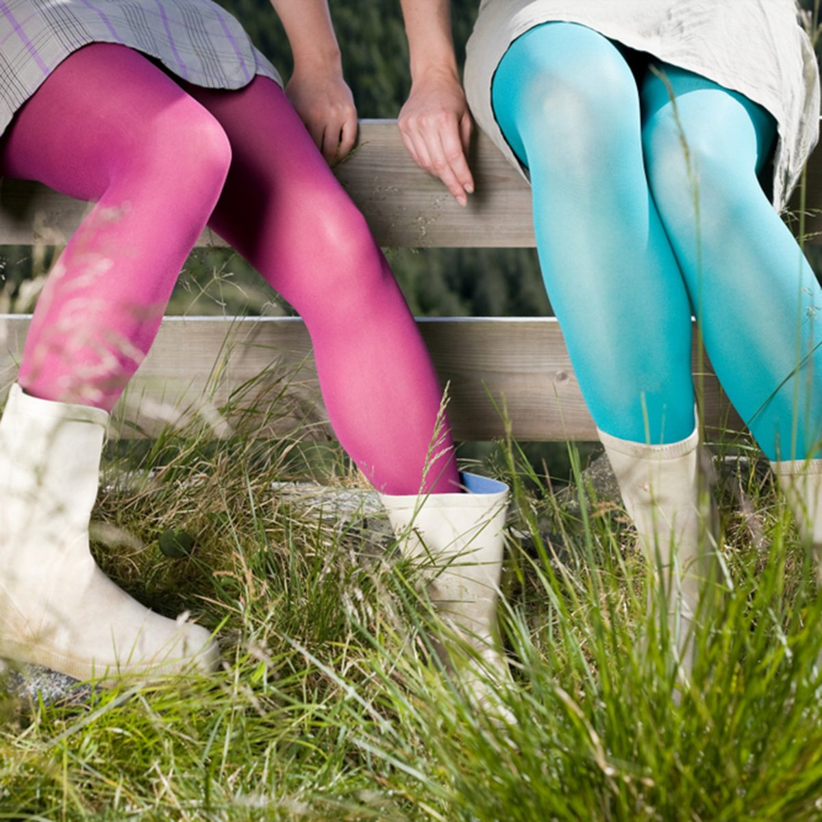 Girls wearing tights sitting on a fence; Shutterstock ID 1086344657; Job (TFH, TOH, RD, BNB, CWM, CM): Taste of Home