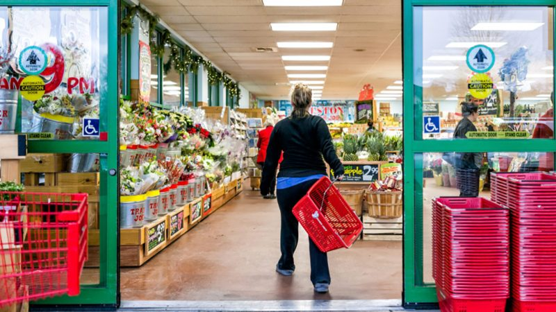 Reston, USA - December 18, 2017: Trader Joe's customer trolley shopping basket carrying carts by store entrance doors outside women, winter flower pots, gardening plants, pineapple in Virginia; Shutterstock ID 1104187877; Job (TFH, TOH, RD, BNB, CWM, CM): Taste of Home