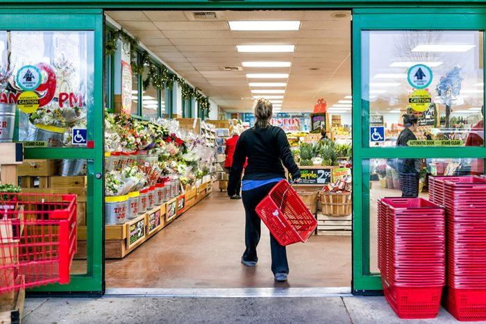 Reston, USA - December 18, 2017: Trader Joe's customer trolley shopping basket carrying carts by store entrance doors outside women, winter flower pots, gardening plants, pineapple in Virginia; Shutterstock ID 1104187877; Job (TFH, TOH, RD, BNB, CWM, CM): Taste of Home