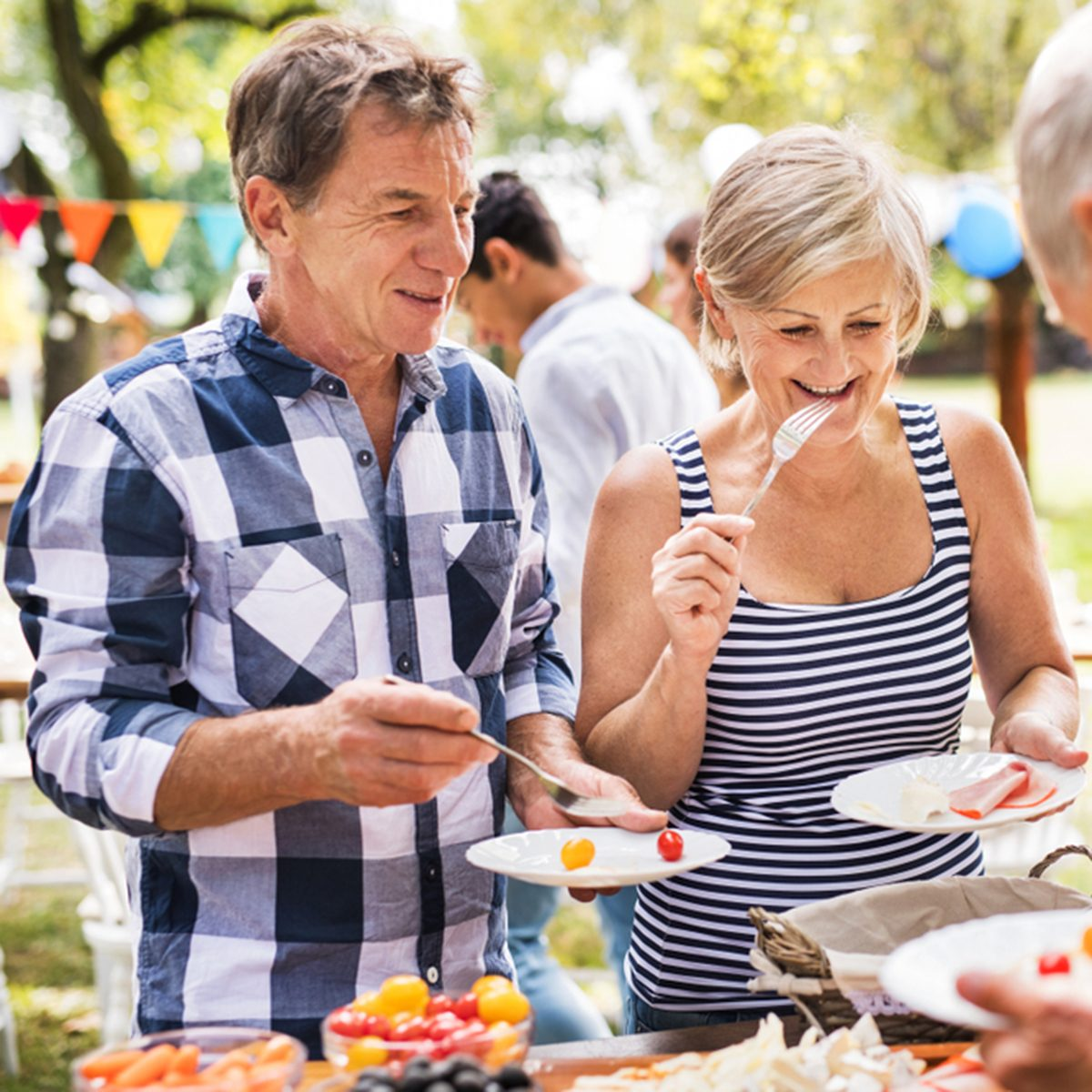 Family celebration or a garden party outside in the backyard.; Shutterstock ID 1109850203; Job (TFH, TOH, RD, BNB, CWM, CM): Taste of Home