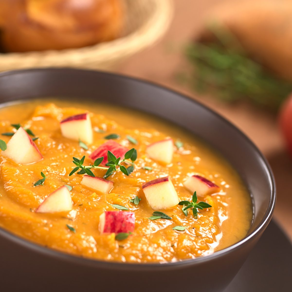 Bowl of fresh homemade sweet potato and apple soup with thyme