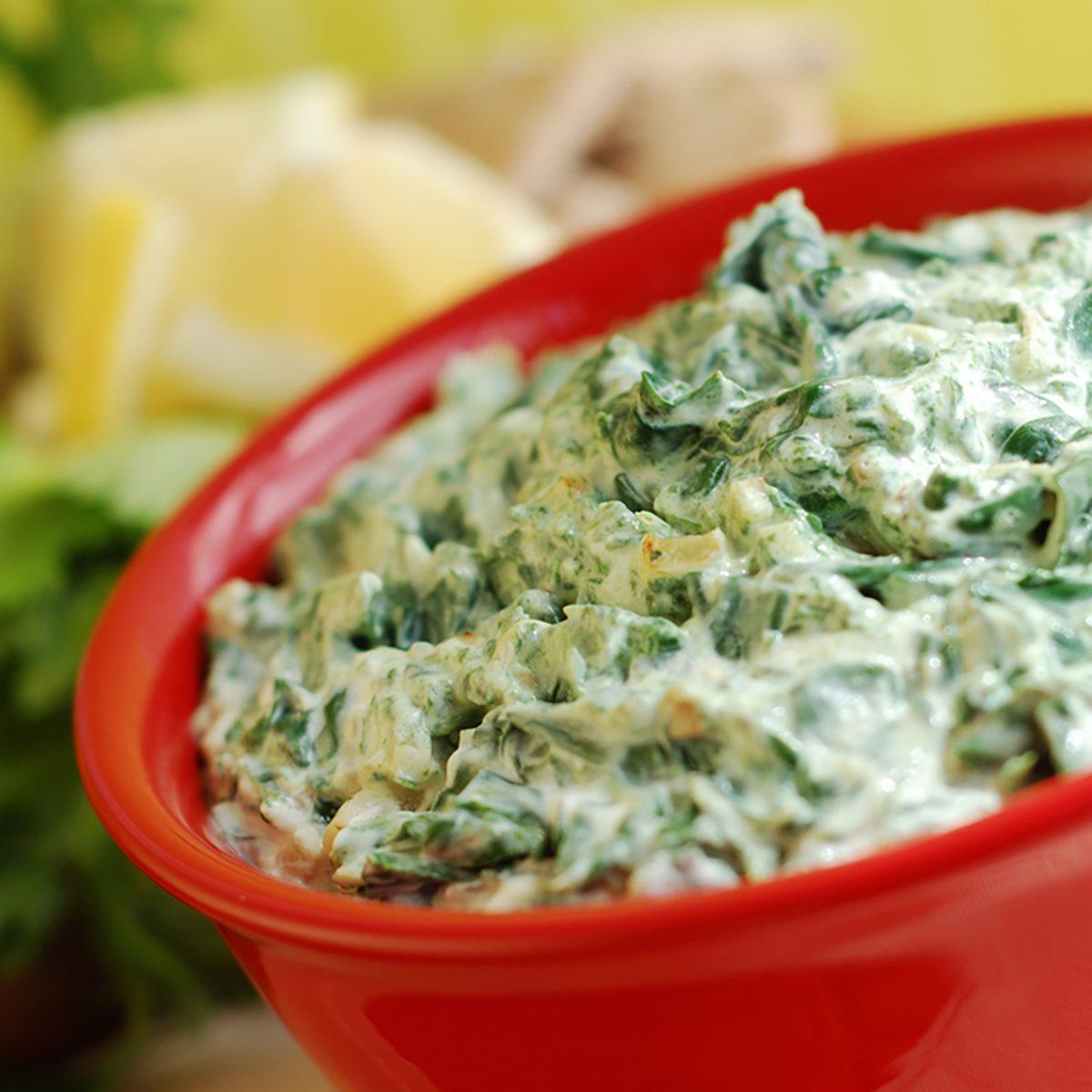 Bowl of fresh vegetarian spinach artichoke dip