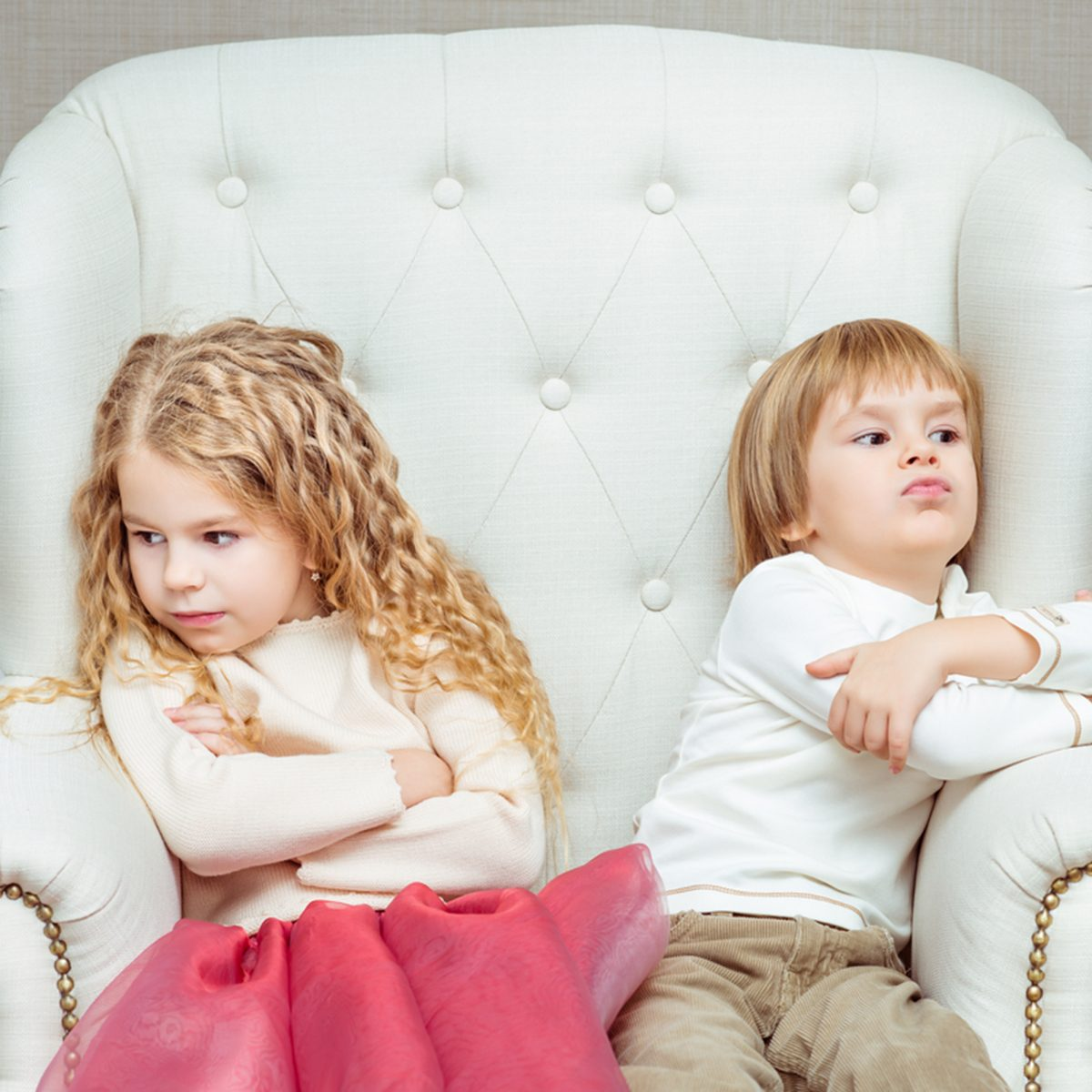 Cute little siblings (boy and girl) being at odds with each other