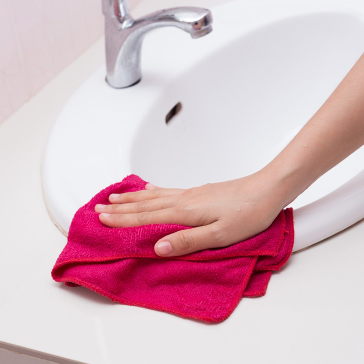 Hand with sponge cleaning white sink.; Shutterstock ID 218603473; Job (TFH, TOH, RD, BNB, CWM, CM): TOH