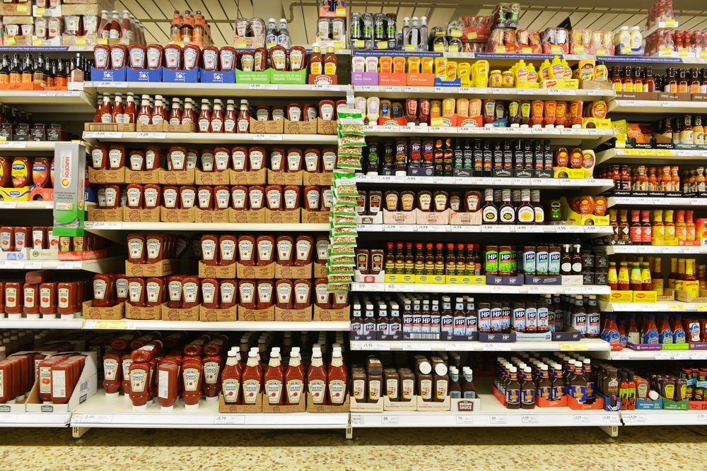 London, UK - December 12, 2014: Shelf view of a Tesco supermarket store. Britain's Tesco supermarket chain is the world's third largest retailer after America's Walmart and France's Carrefour.; Shutterstock ID 237256429
