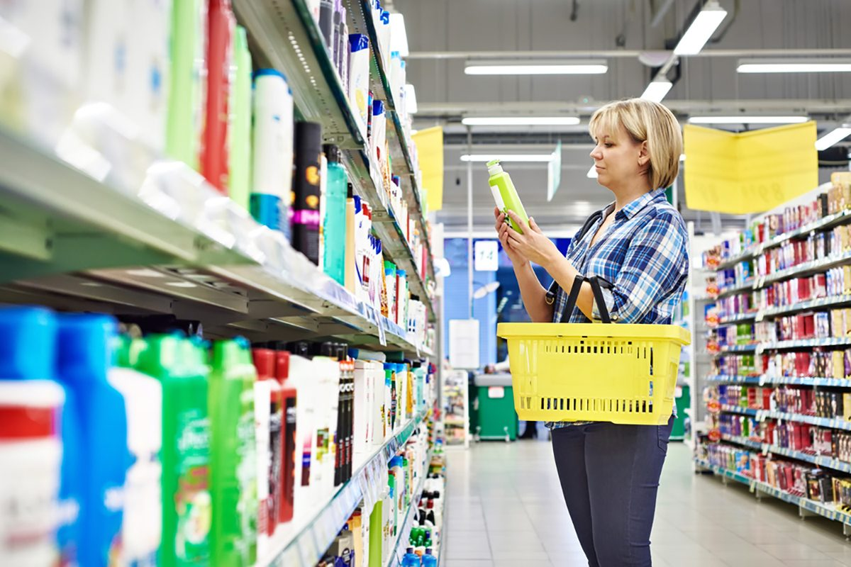 Woman chooses shampoo in cosmetics department in supermarket; Shutterstock ID 251840158; Job (TFH, TOH, RD, BNB, CWM, CM): Taste of Home