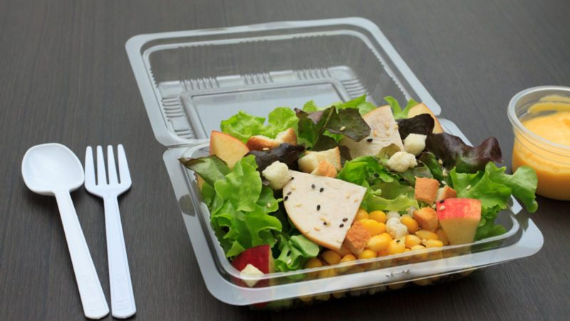 Ham salad with cream in plastic container