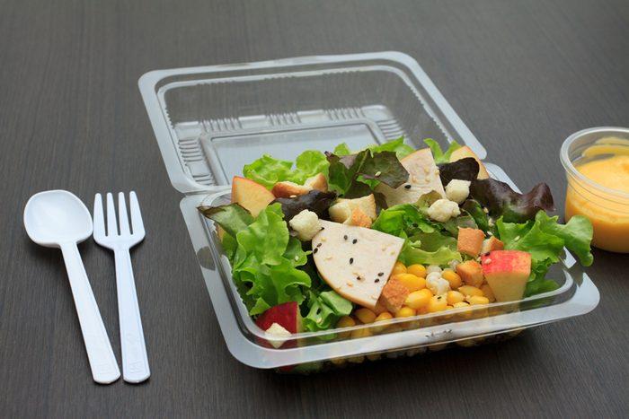 Ham salad with cream in plastic container