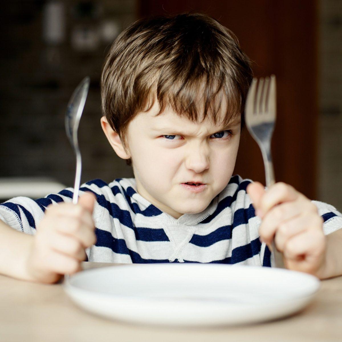 Furious little boy waiting for dinner.