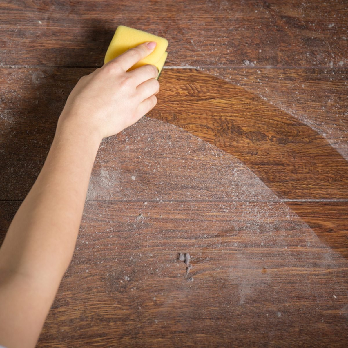 Using yellow sponge for cleaning dusty wood; Shutterstock ID 273329774