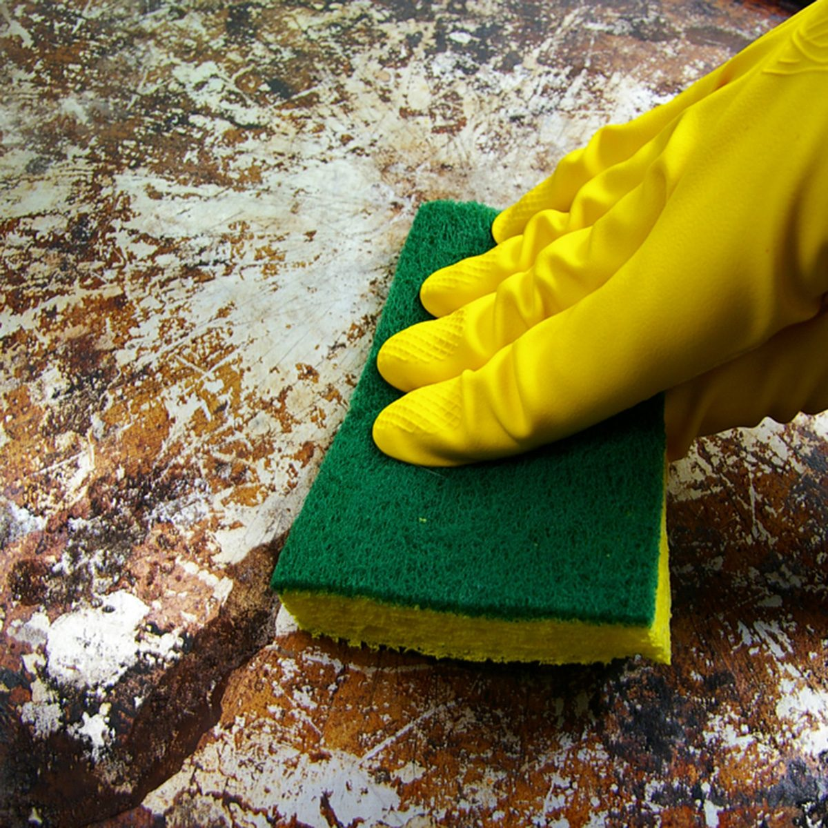 gloved hand scrubbing a dirty metal surface; Shutterstock ID 31317472; Job (TFH, TOH, RD, BNB, CWM, CM): Taste of Home