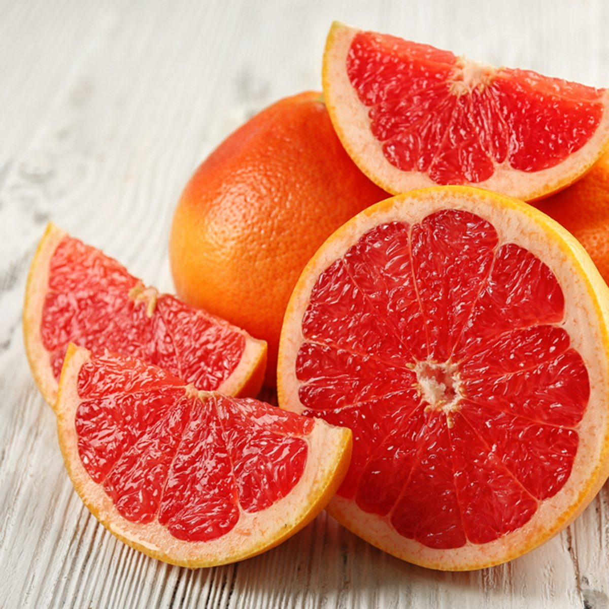 Juicy grapefruits on wooden background; Shutterstock ID 398660866