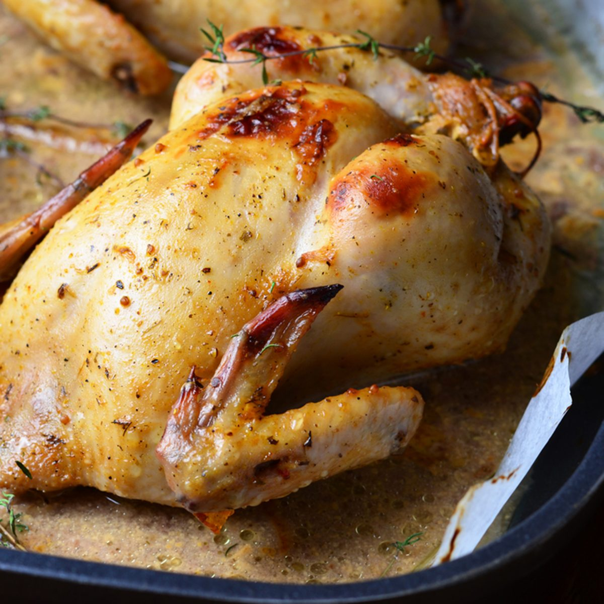 Whole Roasted Chicken with sauce on baking tray