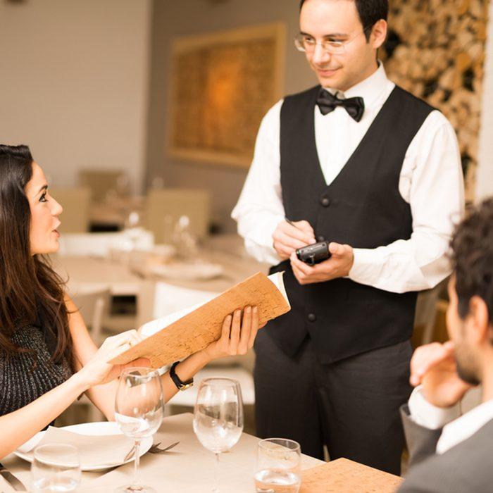 Couple ordering dinner in a luxury restaurant
