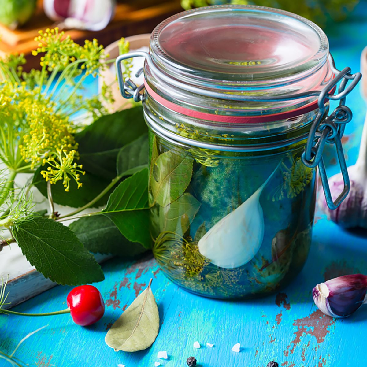 Making pickled cucumbers, homemade pickles in jar on rustic wooden table