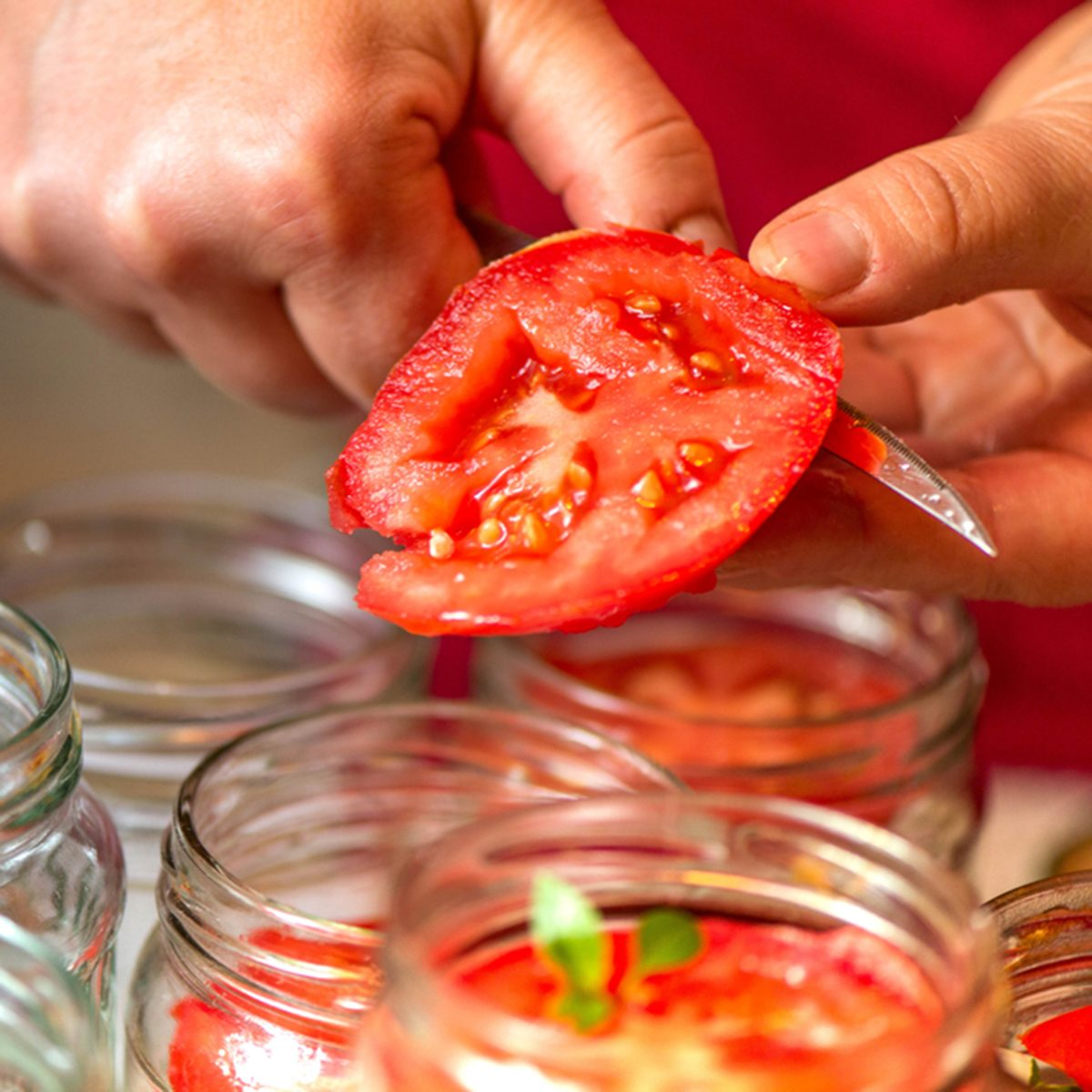 Canning fresh tomatoes with onions in jelly marinade.
