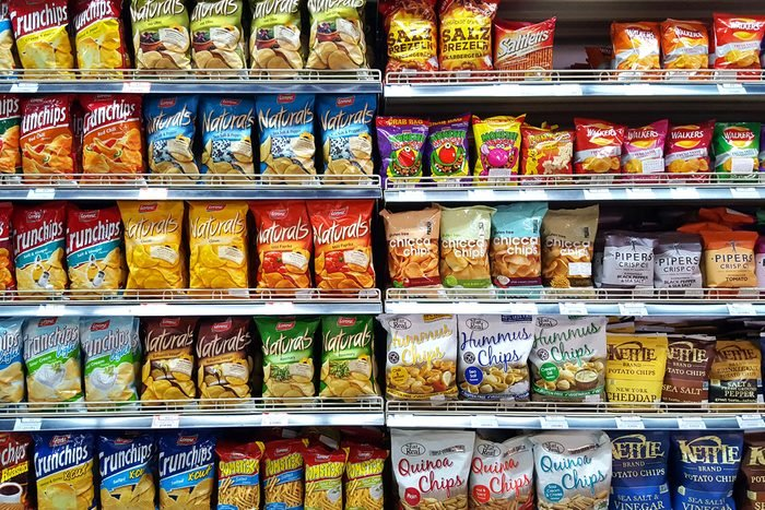 Bangkok, TH - FEBRUARY 14, 2017: Potato chips and snack foods in supermarket shelf that are the cause of an increase fat person.; Shutterstock ID 590612882