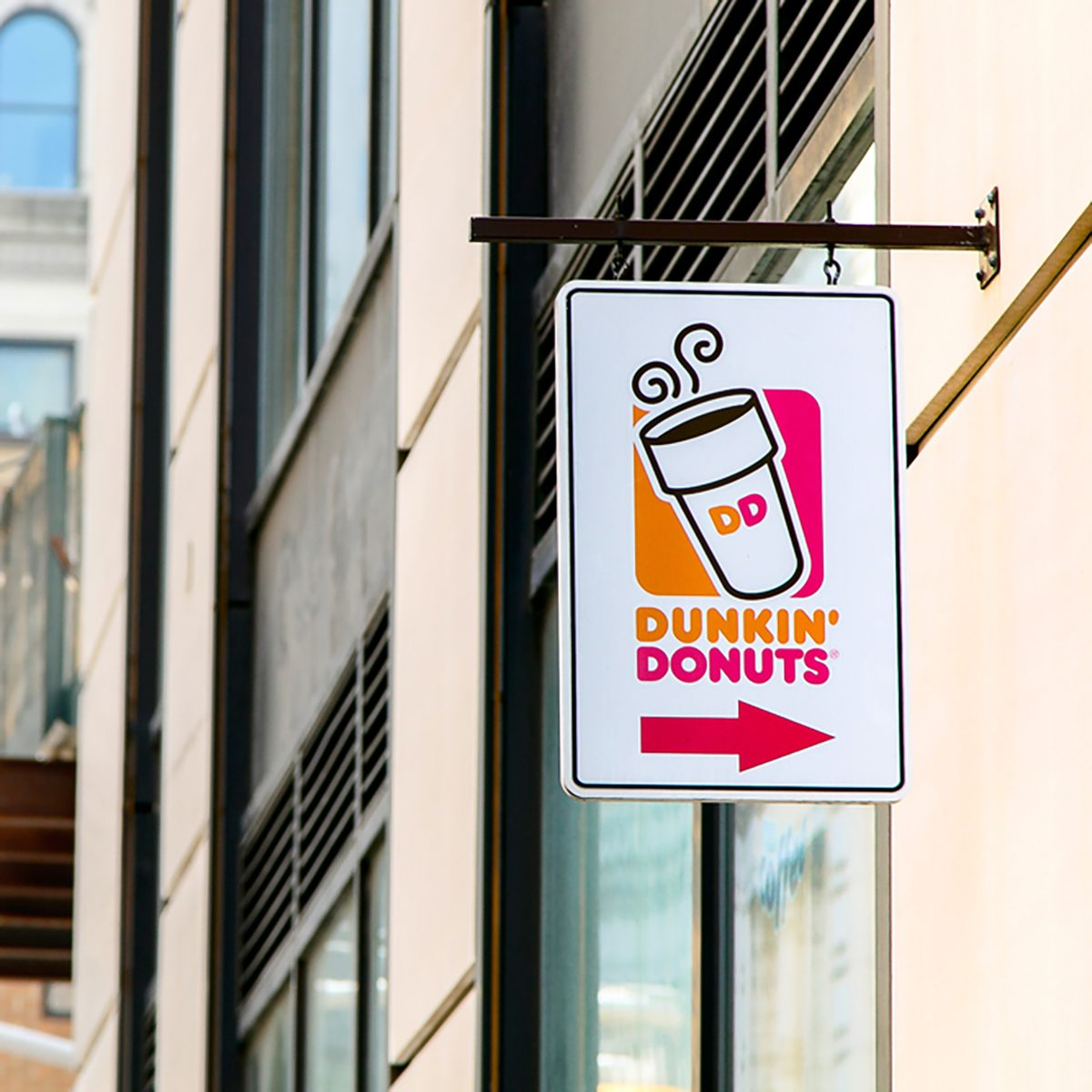 A sign over an entrance to a Dunkin Donuts location in Manhattan