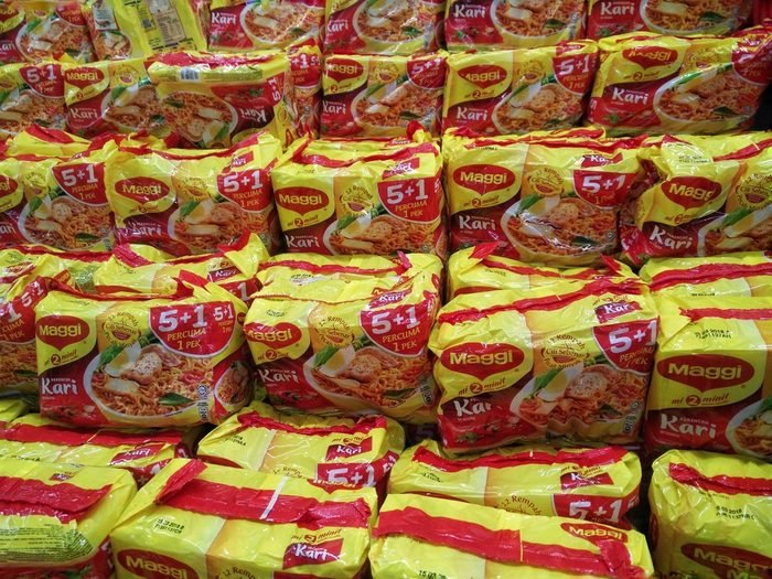 KUALA LUMPUR, MALAYSIA - 18 JUNE, 2017 : Maggi instant noodles. Owned by Nestle, Maggi is an international brand of soups, stocks, bouillon cubes, ketchup, sauces, seasonings and instant noodles.