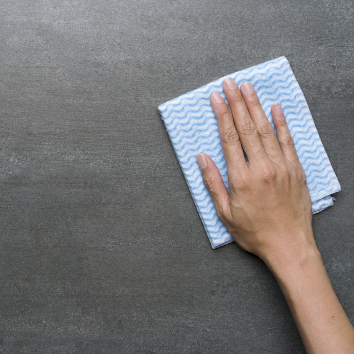 Cleaning black table by woman hand; Shutterstock ID 669645112; Job (TFH, TOH, RD, BNB, CWM, CM): TOH
