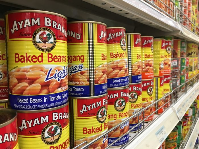 RAWANG, MALAYSIA - SEPTEMBER 15, 2017 : Row of Ayam (Chicken) Brand Baked Beans cans display on the shelf at hypermarket. Ayam Brand believes only in quality ingredients prepared naturally.