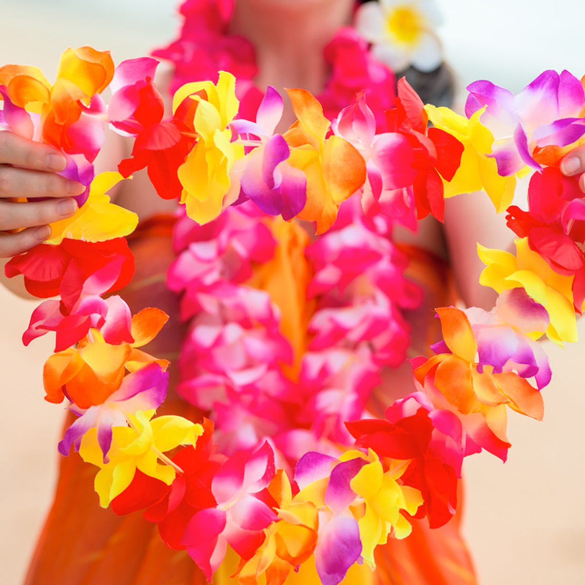 Beautiful floral Hawaiian Lei in the hands of a close-up woman